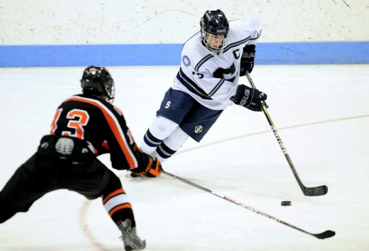 Staples' Tali Laifer controls the puck as Watertown-Pomperaug's Kyle Block defends during the Division III state playoff game at Yale University's Ingalls Rink Saturday, Mar. 19, 2011.