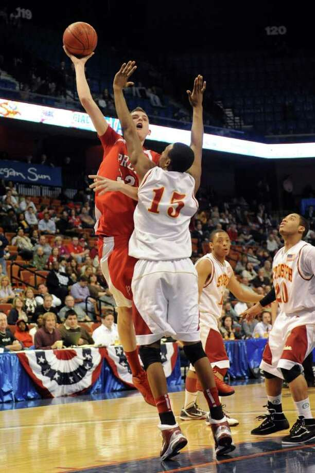 Fairfield Prep's Matt Daley takes a shot as St. Joseph's Timajh Parker defends during Saturday's Class LL State Final game at Mohegan Sun Arena on March 19, 2011. Photo: Lindsay Niegelberg / Connecticut Post