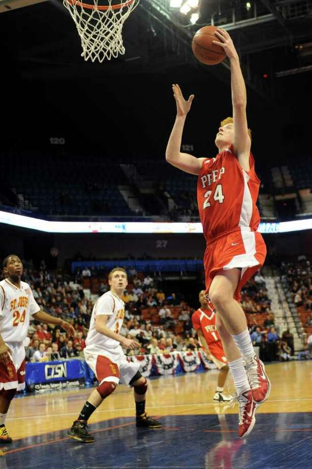 Fairfield Prep's Alex Heiman takes a shot during Saturday's Class LL State Final game at Mohegan Sun Arena on March 19, 2011. Photo: Lindsay Niegelberg / Connecticut Post