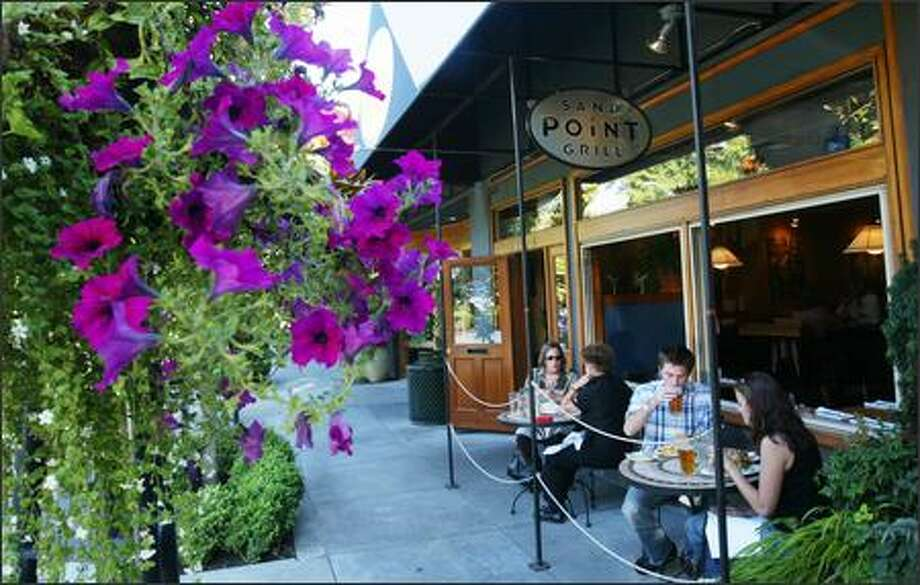 Patrons enjoy their meals and the weather in the outside dining area of the Sand Point Grill in Seattle. A new executive chef, Charlie Durham, has restored the luster of the 7-year-old neighborhood restaurant. Photo: Dan DeLong/Seattle Post-Intelligencer
