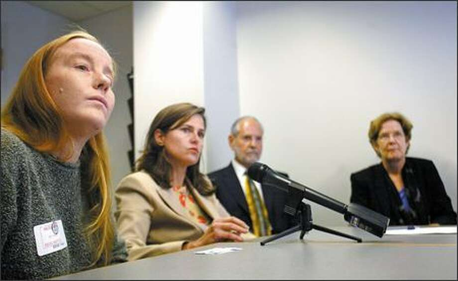 Christine Drake, left, and the Equal Employment Opportunity Commission's Lisa Cox, Luis Lucero and Kathryn Olson meet with the media at the Federal Building. Photo: Karen Ducey/Seattle Post-Intelligencer