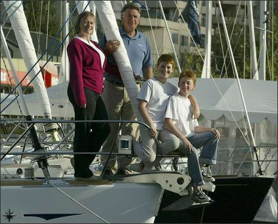 Jeanna and Jim Rard and their twin daughters, Jessie and Molly, 12, of Arlington are preparing to embark on a two-year sail around the world on their new, 49-foot cutter, the Ruby Slippers. Photo: Grant M. Haller/Seattle Post-Intelligencer