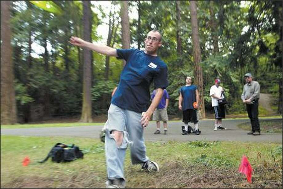 Jason Metheny of Blaine plays disc golf with the Bellingham Disc Golf Club at Cornwall Park in Bellingham. The course is a pleasant, tree-covered area complete with picnic tables and walking paths that extend over several acres. Cornwall Park is considered a beginner's course, one without too much in the way of obstacles and that is easy to follow. Photo: KAREN DUCEY/P-I