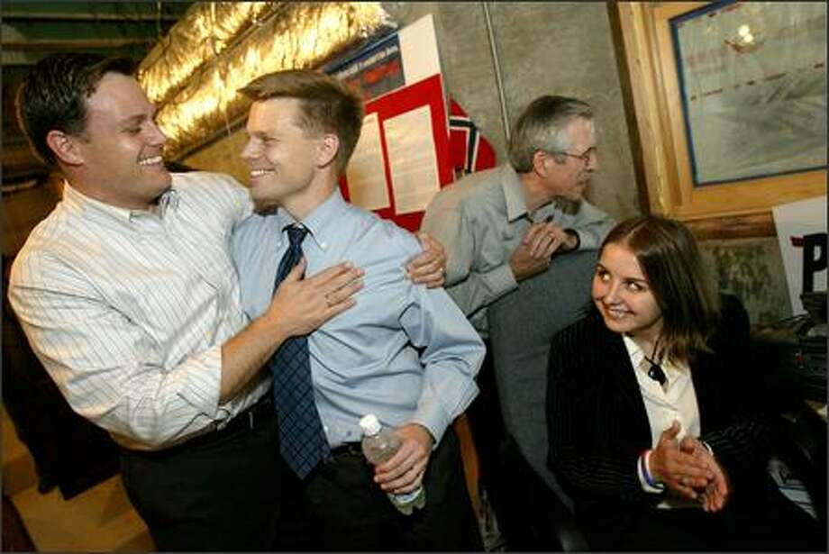 Jamie Pedersen, center, is congratulated by partner Eric Cochran and campaign manager Cammie Croft, right, in campaign headquarters on Capitol Hill as the first results came in. Photo: Joshua Trujillo/Seattle Post-Intelligencer