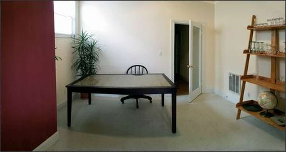 Before: The dining room was dark, depressing and decidely unwelcoming before the makeover. Photo: /