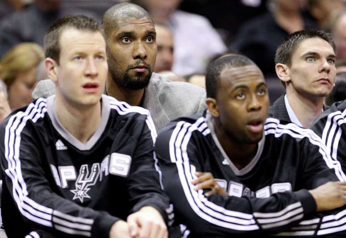 FOR SPORTS - Spurs' Tim Duncan watches first half action against the Bobcats from the bench with teammates Saturday March 19, 2011 at the AT&T Center. (PHOTO BY EDWARD A. ORNELAS/eaornelas@express-news.net)