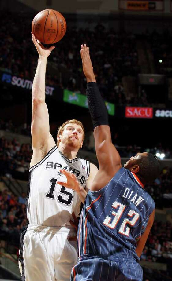 FOR SPORTS - Spurs'  Matt Bonner shoots over Bobcats' Boris Diaw during first half action Saturday March 19, 2011 at the AT&T Center.  (PHOTO BY EDWARD A. ORNELAS/eaornelas@express-news.net) Photo: EDWARD A. ORNELAS, SAN ANTONIO EXPRESS-NEWS / SAN ANTONIO EXPRESS-NEWS NFS