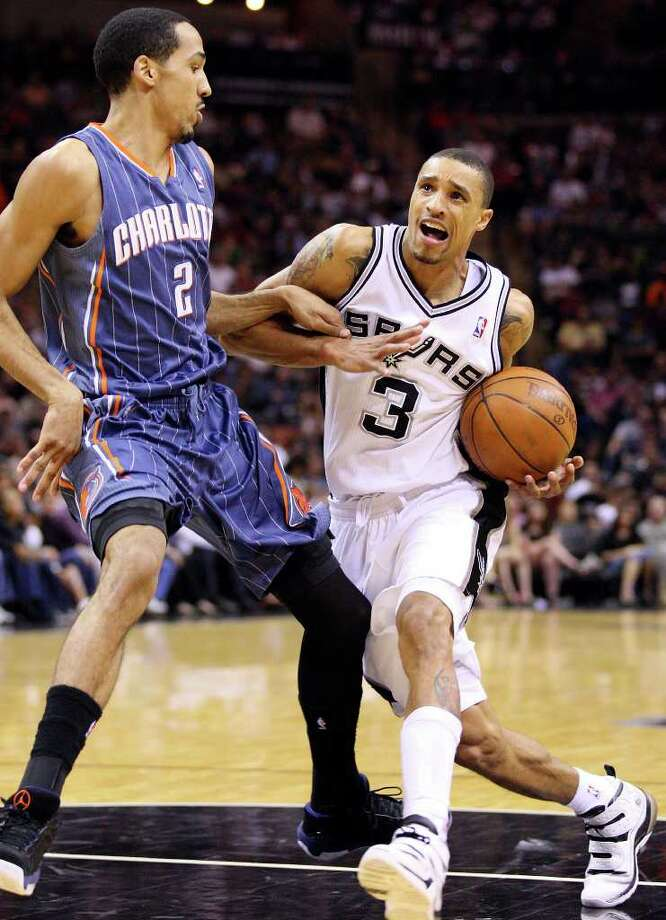 FOR SPORTS - Spurs' George Hill looks for room around  Bobcats' Shaun Livingston during second half action Saturday March 19, 2011 at the AT&T Center. The Spurs won 109-98.  (PHOTO BY EDWARD A. ORNELAS/eaornelas@express-news.net) Photo: EDWARD A. ORNELAS, SAN ANTONIO EXPRESS-NEWS / SAN ANTONIO EXPRESS-NEWS NFS