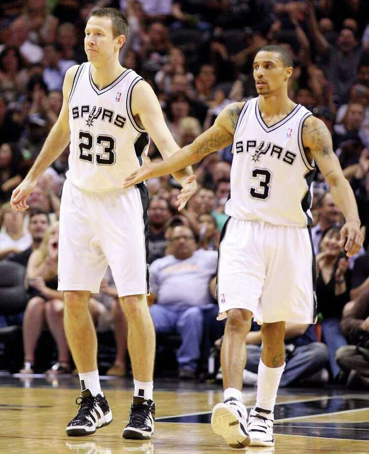 FOR SPORTS - Spurs' Steve Novak is congratulated by teammate George Hill after Novak scored a three pointer against the  Bobcats during second half action Saturday March 19, 2011 at the AT&T Center. The Spurs won 109-98.  (PHOTO BY EDWARD A. ORNELAS/eaornelas@express-news.net) Photo: EDWARD A. ORNELAS, SAN ANTONIO EXPRESS-NEWS / SAN ANTONIO EXPRESS-NEWS NFS
