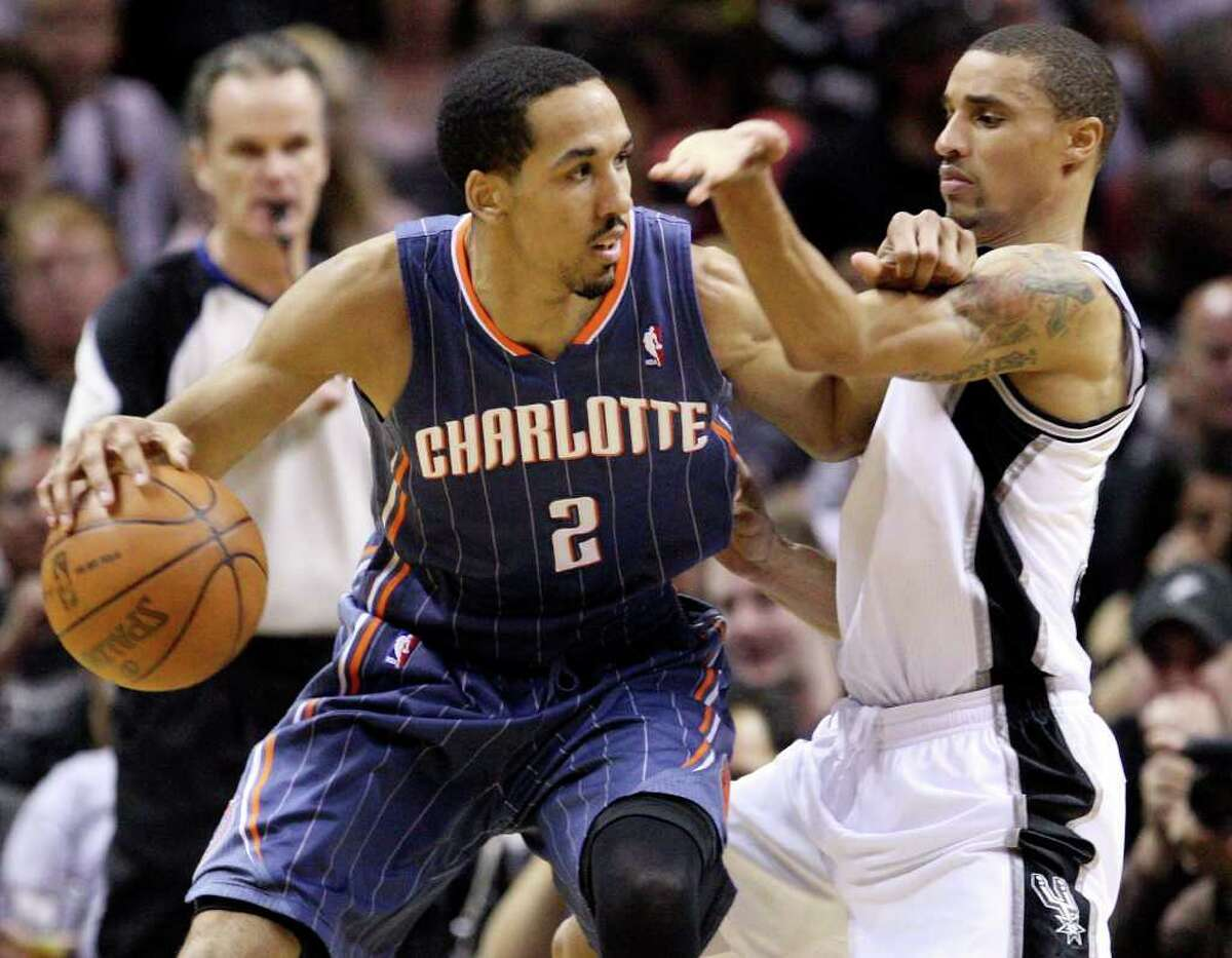 FOR SPORTS - Spurs' George Hill defends Bobcats' Shaun Livingston during second half action Saturday March 19, 2011 at the AT&T Center. The Spurs won 109-98. (PHOTO BY EDWARD A. ORNELAS/eaornelas@express-news.net)