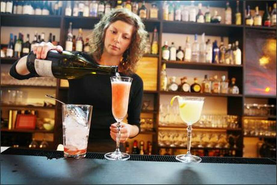 Michele Balkwill tends a bar of original and good flavored drinks. Photo: Joshua Trujillo/Seattle Post-Intelligencer