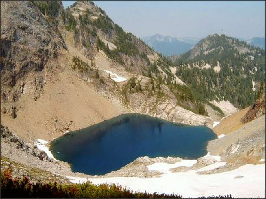 Chair Peak Lake, as seen from 5,400-foot Melakwa Pass, looks inviting but doesn't get many visitors. Photo: KAREN SYKES