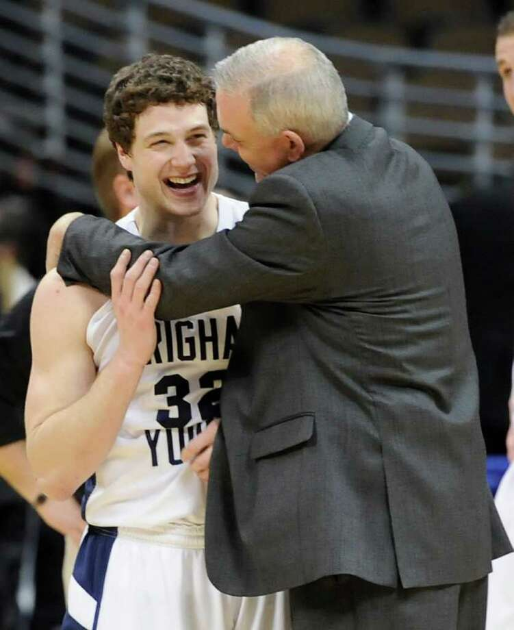 BYU's Jimmer Fredette, left, celebrates with coach Dave Rose after BYU beat Gonzaga 89-67 in a Southeast regional third round NCAA tournament college basketball game, Saturday, March 19, 2011, in Denver. (AP Photo/Jack Dempsey) Photo: Jack Dempsey