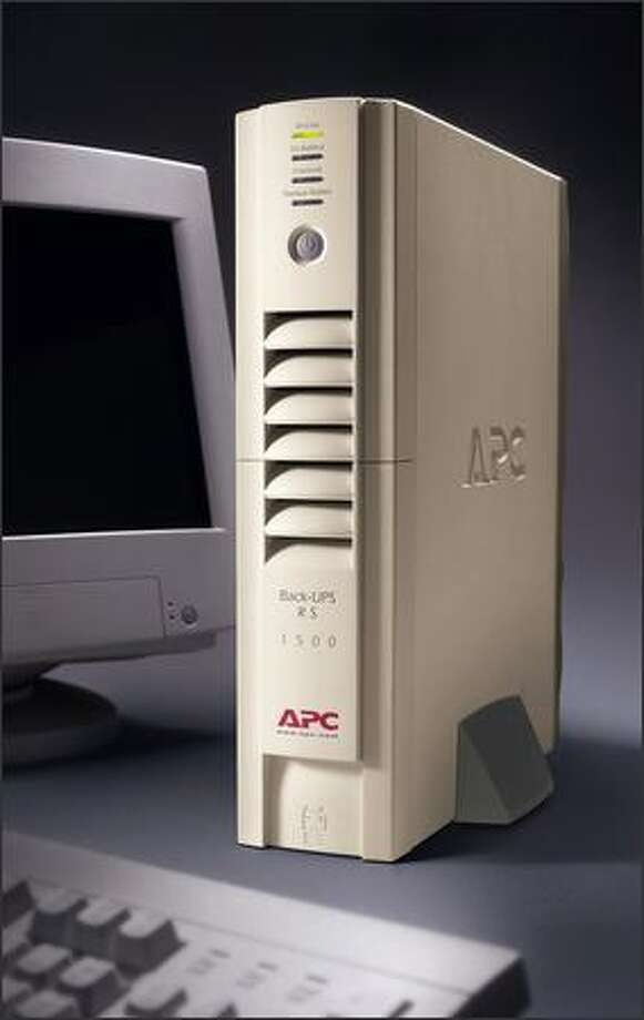 This is a tower-style uninterruptible power supply system that will power a personal computer and peripheral components. The indicator lights at the top allow you to monitor the unit at a glance. Photo: /