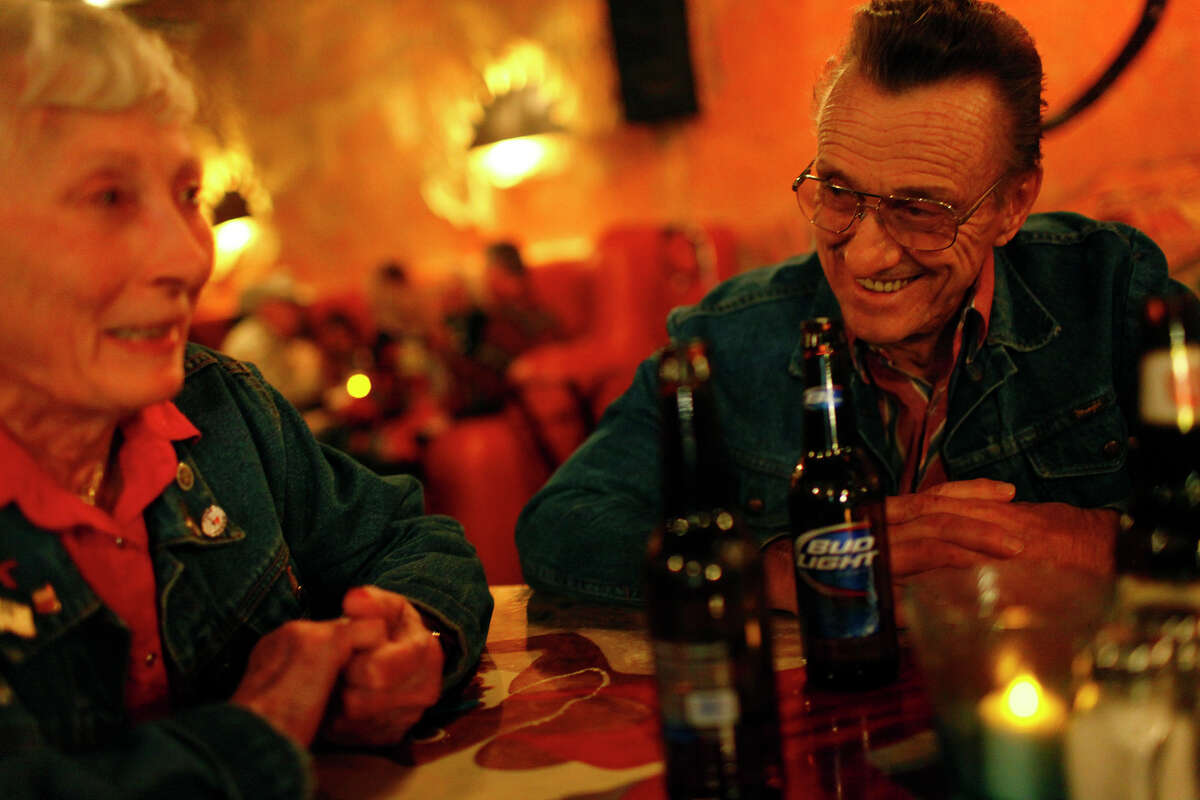 """Terlingua residents Nita Brashear and Ray Masseau spend an evening at the CD release party for """"The Bent Lovehandles."""""""