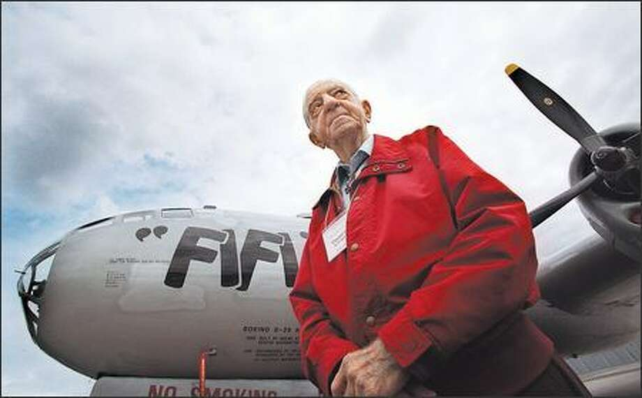 Clayton Scott shown at Boeing Field in front of a B-29, a bomber he flew as a test pilot during its development in World War II. He grew interested in flying after seeing a barnstormer as a child. Photo:  P-I File (1997)