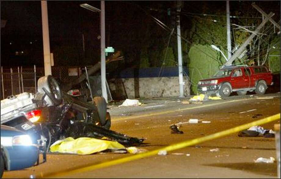 Four people were killed in this car crash on the 5600 block of Rainier Avenue South Saturday. Photo: Karen Ducey/Seattle Post-Intelligencer