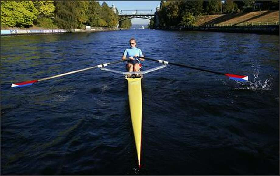 Holy Names senior Lindsay Meyer, a member of the team at the Pocock Rowing Center in Seattle, works out in her single scull on the Lake Washington Ship Canal. Photo: Scott Eklund/Seattle Post-Intelligencer