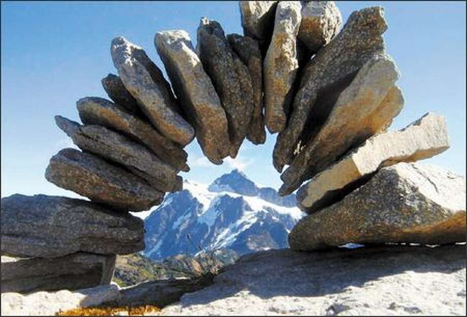 Sometimes fantastical cairns mark routes on Table Mountain, such as this one framing Mount Shuksan along the Table Mountain Trail. Photo: Karen Sykes/Special To The Post-Intelligencer