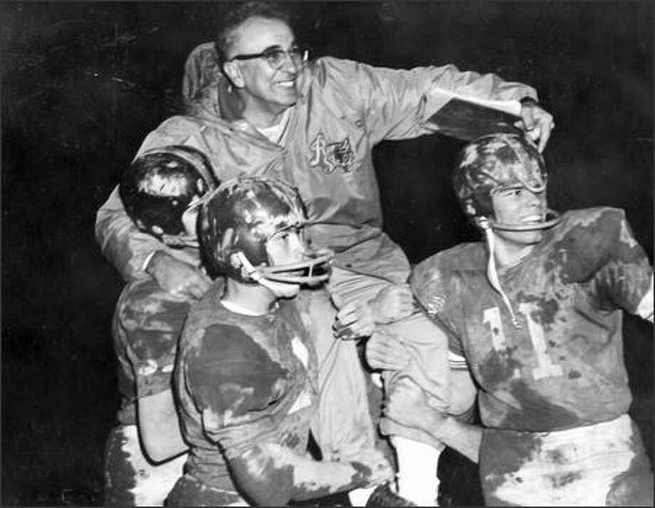 Then: Rick Dominy (11) and Ingraham teammates give legendary Metro League coach Tony Gasparovich a lift after a Rams victory. Photo: Courtesy Of Rick Dominy