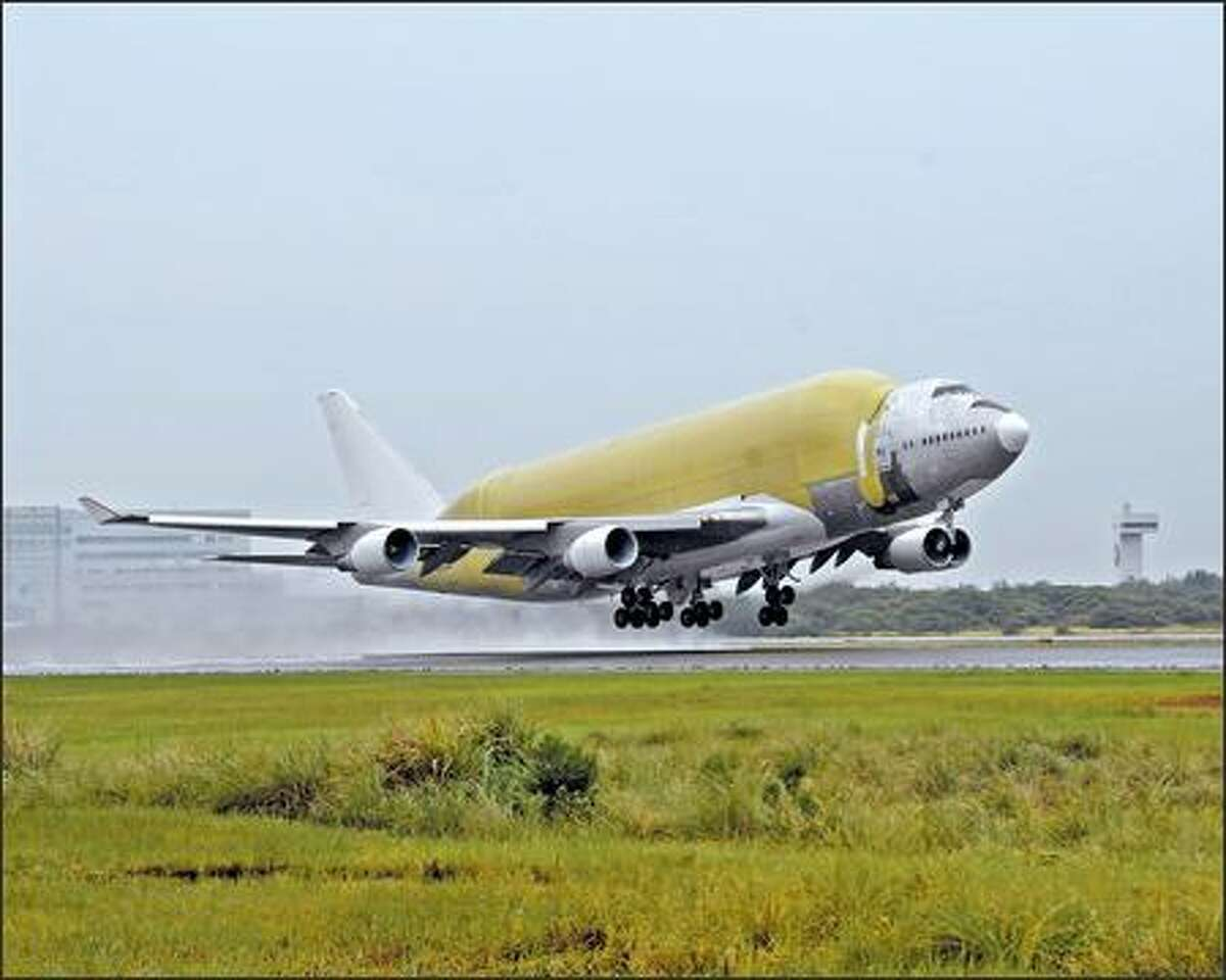 Large Cargo Freighter makes is maiden flight in Taipei, Taiwan. The modified 747 will be used to haul fuselage barrels and the wings of the 787 to Everett.