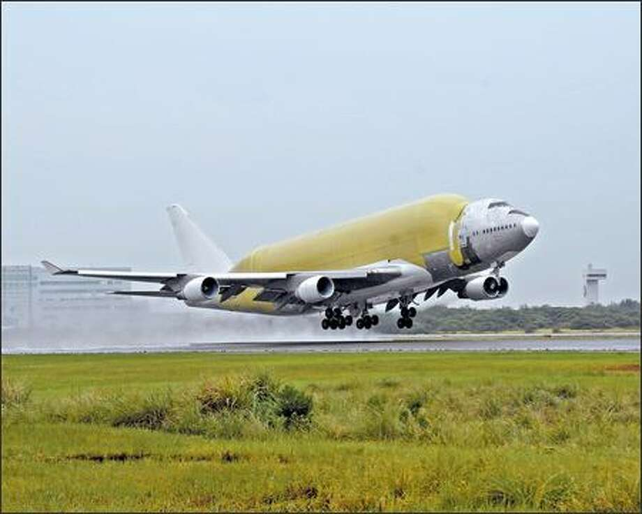 Large Cargo Freighter makes is maiden flight in Taipei, Taiwan. The modified 747 will be used to haul fuselage barrels and the wings of the 787 to Everett. Photo: / The Boeing Company