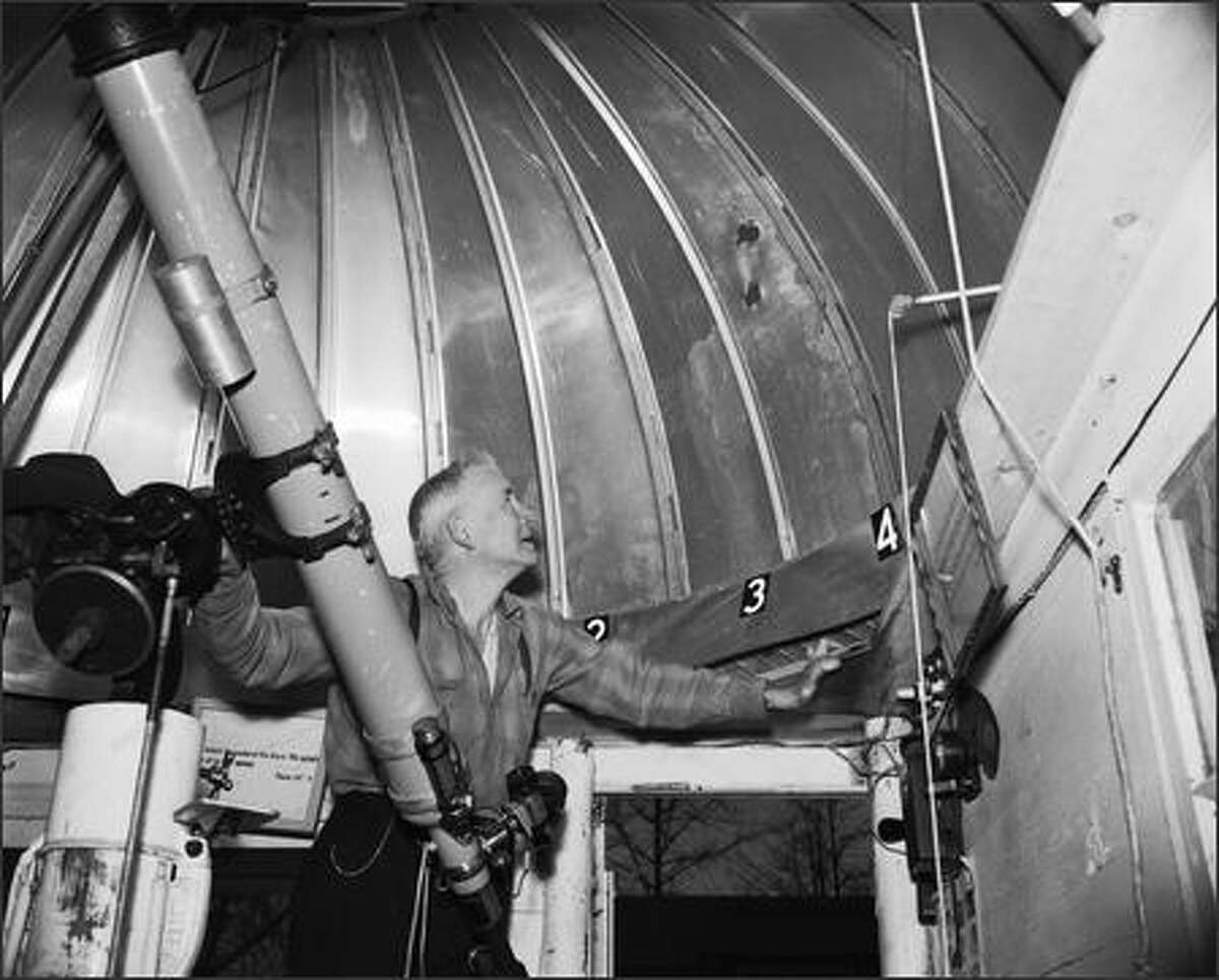 Luther L. Hawthorne in his backyard observatory.