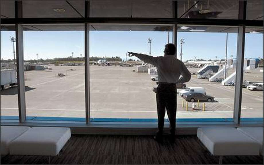 "Jack Jones, director of the delivery center at Boeing's Paine Field in Everett, says customers and employees helped ""brainstorm"" ideas for remodeling the center. Photo: Gilbert W. Arias/Seattle Post-Intelligencer"