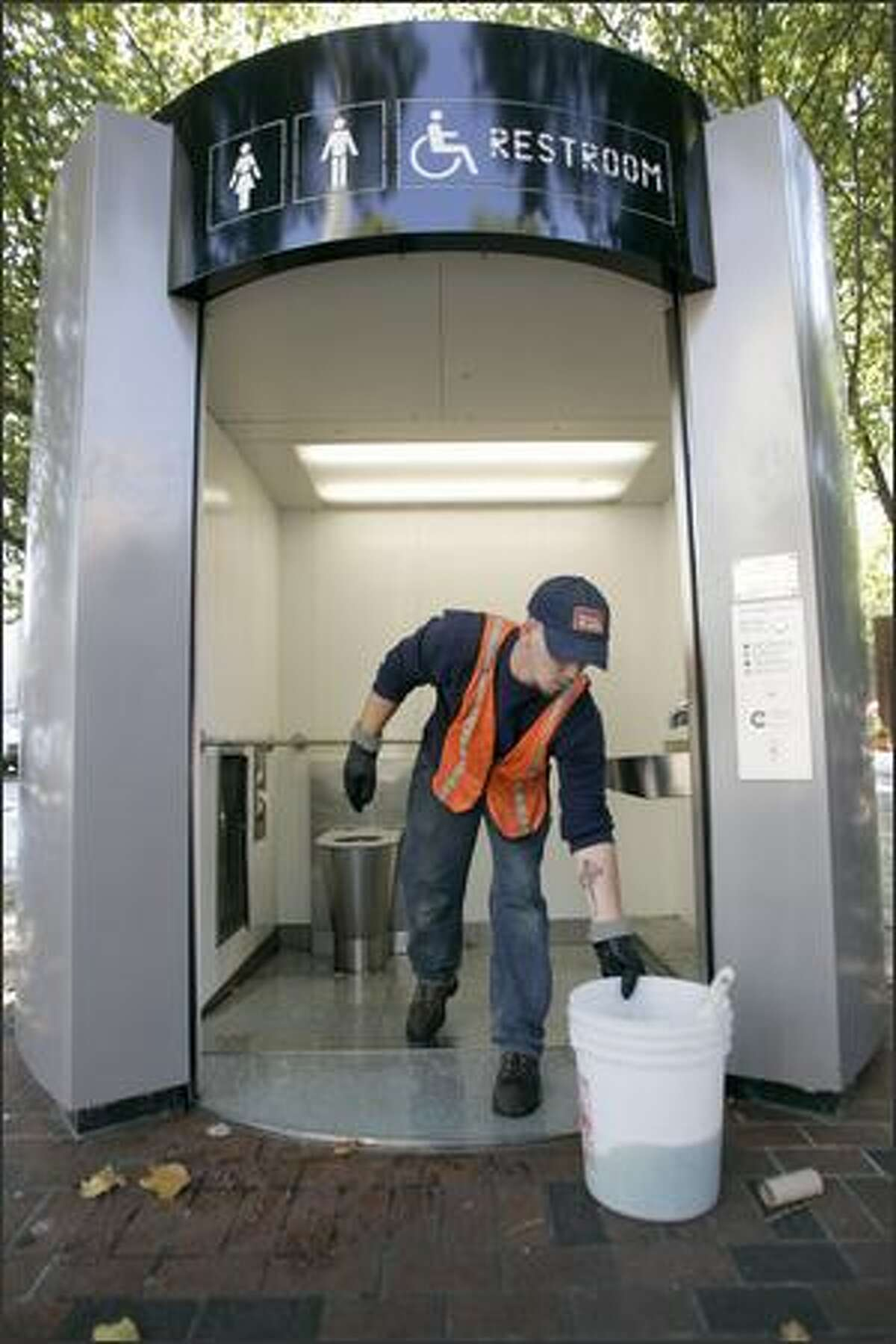 Honey Bucket route driver Joe Powers cleans the automated public toilet in Occidental Square downtown on Wednesday. The city decided in 2004 to spend nearly $700,000 a year to maintain five high-tech toilets.