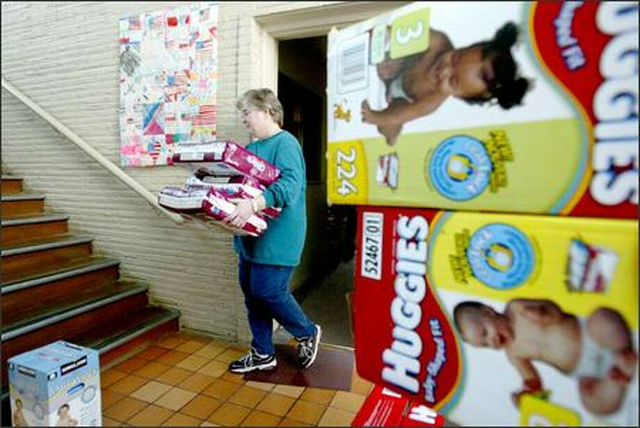 Jeannie Jaybus, director and co-founder of St. Joseph's Baby Corner, stores donated diapers that will help replace those recently stolen. Photo: Paul Joseph Brown/Seattle Post-Intelligencer