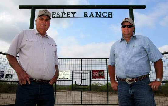 Edwin Espey (left) and son Justin run a cattle and hunting operation in McMullen County over the Eagle Ford shale formation. Their land would be taken under the National Guard plan. Photo: John Davenport/Express-News / SAN ANTONIO EXPRESS-NEWS (Photo can be sold to the public)
