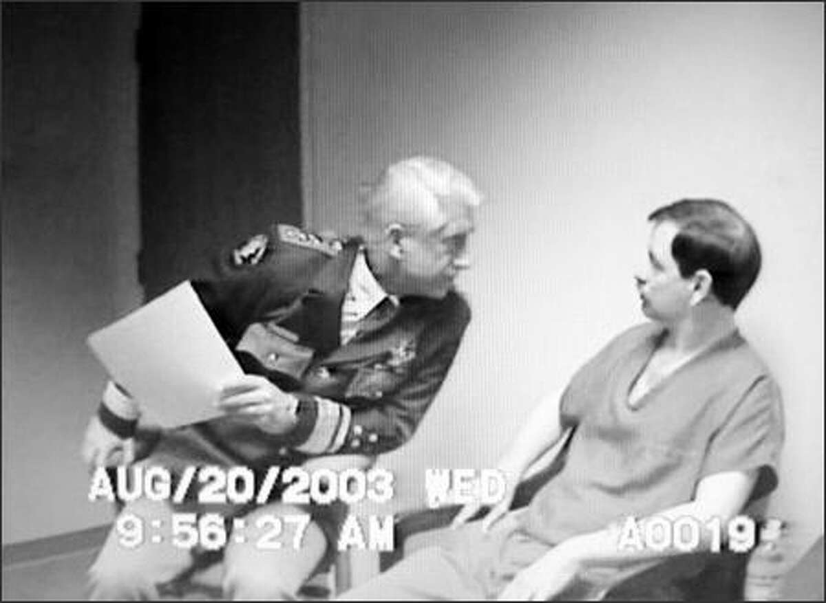 As King County sheriff, Dave Reichert questions Green River Killer Gary Ridgway in August 2003.