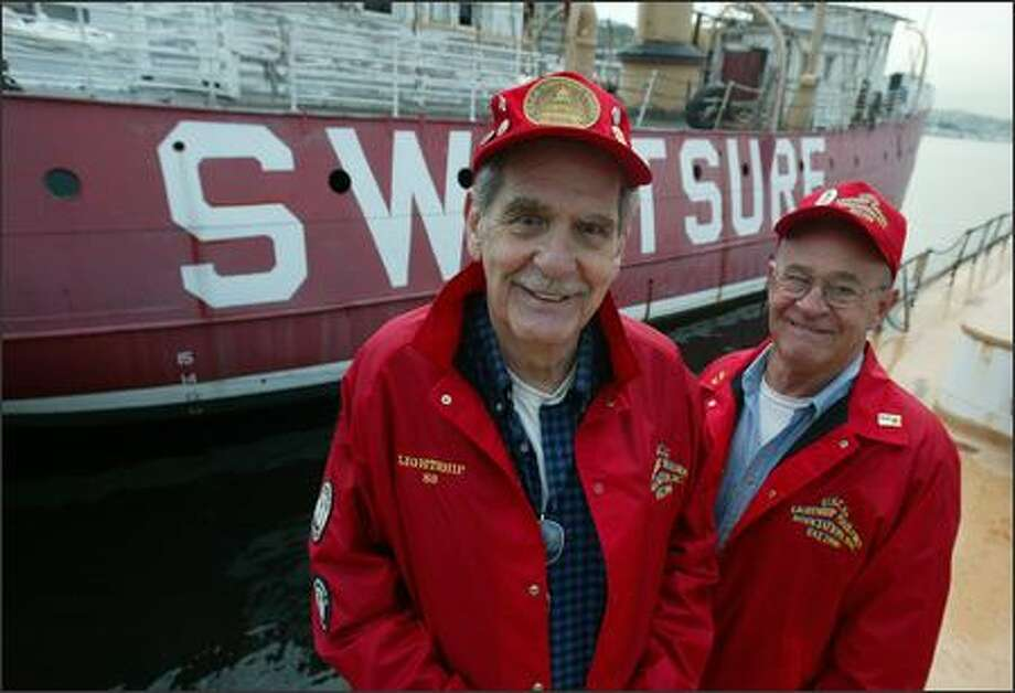 U.S. Coast Guard veterans Joe Ratcliffe and Arnold Holt served on the Swiftsure Lightship No. 83. They are in Seattle for a national reunion for Coast Guard members who manned lightships. Photo: Paul Joseph Brown/Seattle Post-Intelligencer