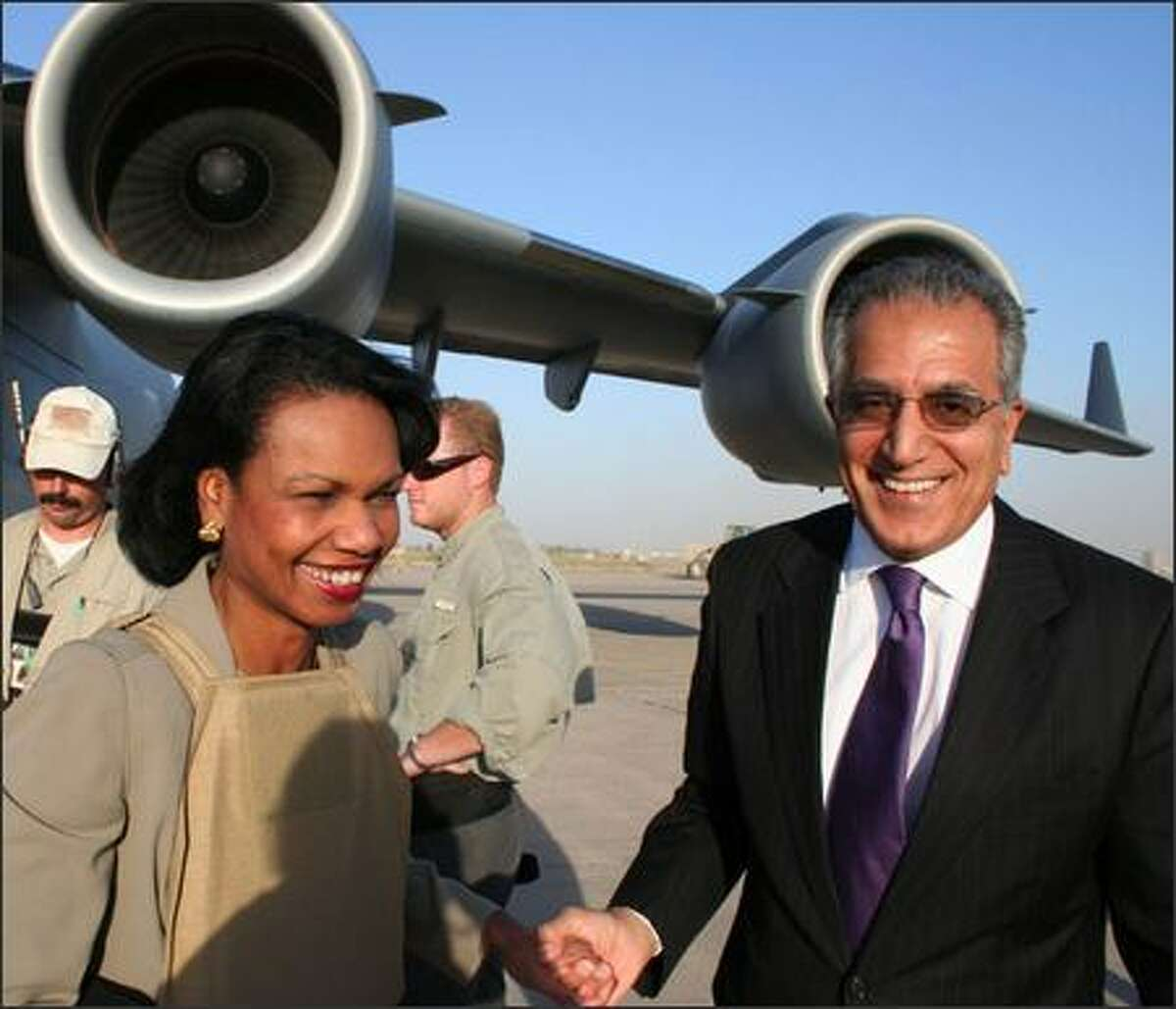 Secretary of State Condoleezza Rice arrived Thursday in Baghdad for meetings with Iraqi political leaders. She's pictured with U.S. Ambassador Zalmay Khalilzad.