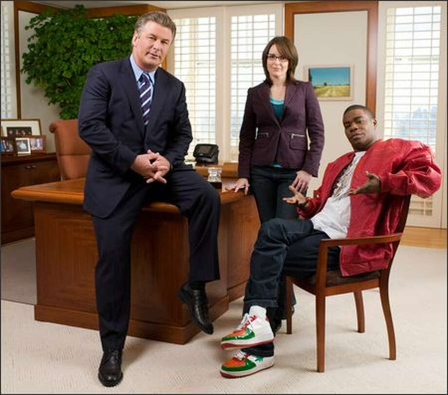 "NBC's ""30 Rock,"" a new sitcom about network TV stars, from left, Alex Baldwin, Tina Fey and Tracy Morgan. Photo: / NBC"