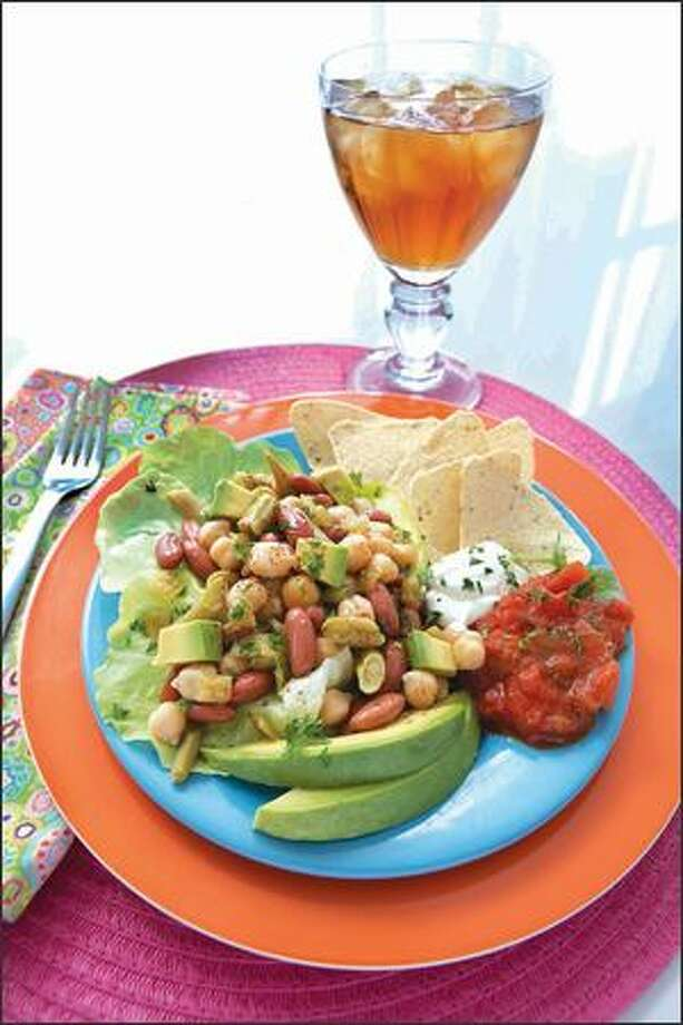 Mexican Bean Salad combines garbanzo, red kidney and green beans with green chiles, served atop Boston lettuce and avocados. (PHOTO BY THERESA RAFFETTO / FOOD STYLING BY JOYCE SANGIRARDI) Photo: /