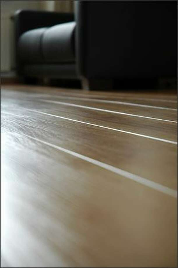 Wood floors sometimes smooth out a few months after being refinished, but if not, it might be time to call back the finishers. Photo: /