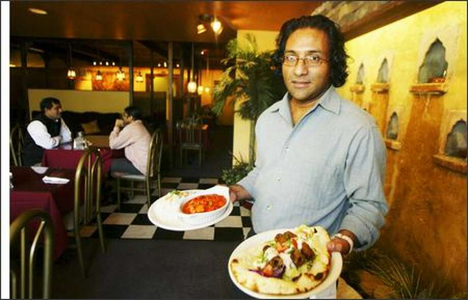 Shalimar owner Wasif Qadri displays Vegetable Jaipuri, left, and a Seehk Kabob sandwich. Photo: Jim Bryant/Seattle Post-Intelligencer