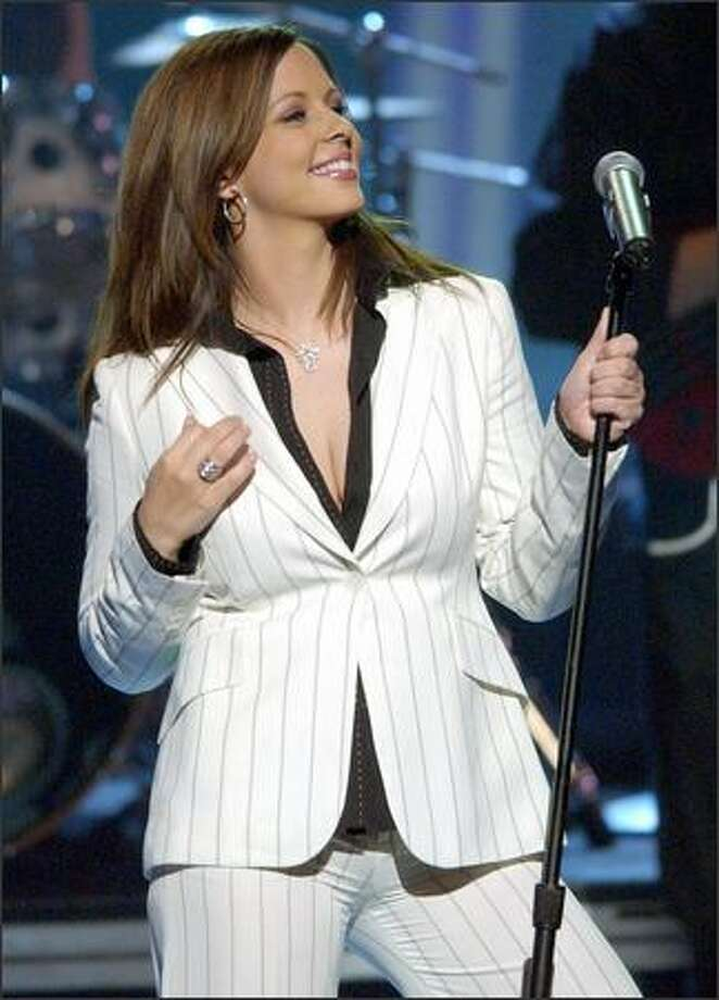 "Sara Evans performs ""I Keep Looking"" during the 37th Annual Academy of Country Music Awards in 2002 in Los Angeles. Photo: / Associated Press"