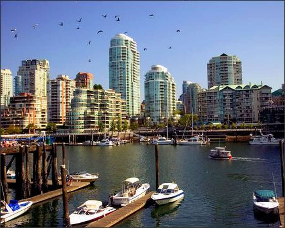 Apartments and condos make up this part of the Vancouver, B.C., skyline. Many families live downtown. Photo: / Associated Press