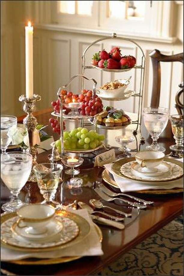 Pump up the volume on a dining table -- or any display. Some antique dessert servers bring instant elegance to this luncheon table. Photo: BOB GREENSPAN