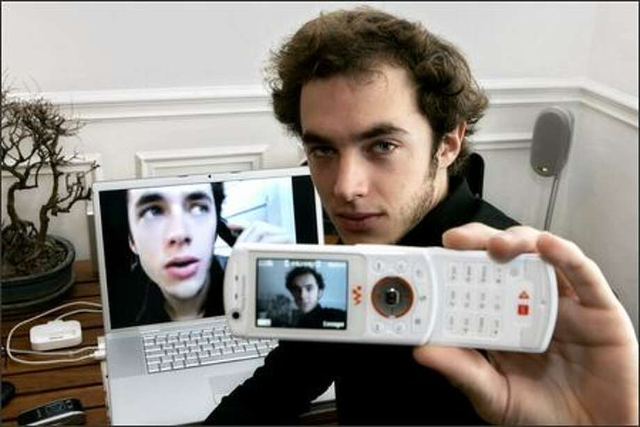 """Leonard Bourgois-Beaulieu used this mobile phone to film """"Busy"""" and edited it on this computer. Photo: / Associated Press"""