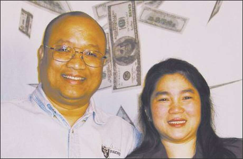 Sommay Rattanakone and his wife, Xia, bought their winning Mega Millions ticket at the North Bend Safeway store. (WASHINGTON'S LOTTERY) Photo: /