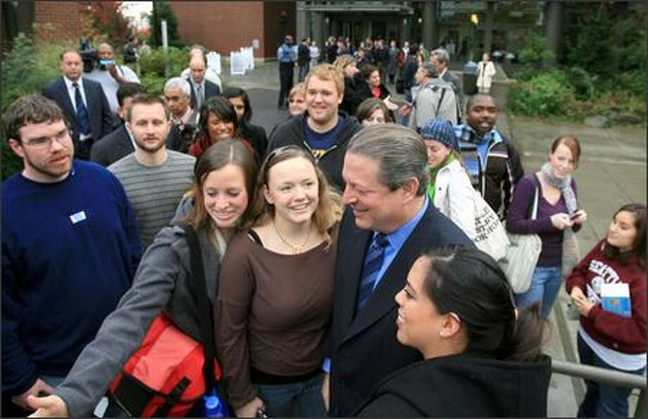 Former Vice President Al Gore is greeted by Seattle University students Tuesday after speaking on a panel about global warming and stumping for Democratic Sen. Maria Cantwell and 8th Congressional District candidate Darcy Burner. One supporter said Gore told her he'd think about a run in 2008. Photo: Dan DeLong/Seattle Post-Intelligencer