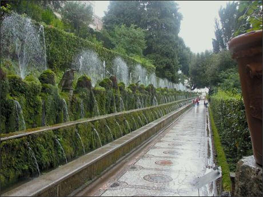 Inspirations from Tivoli Gardens near Rome include mosaic walkways, moss, long vistas, and fountains that cool outdoor spaces. Photo: DEBRA WINSLOW PHOTOS