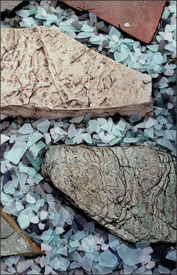 """Colorful recycled glass """"pebbles"""" look nice between steppingstones or as a decorative mulch in containers. Photo: P-I FILE"""