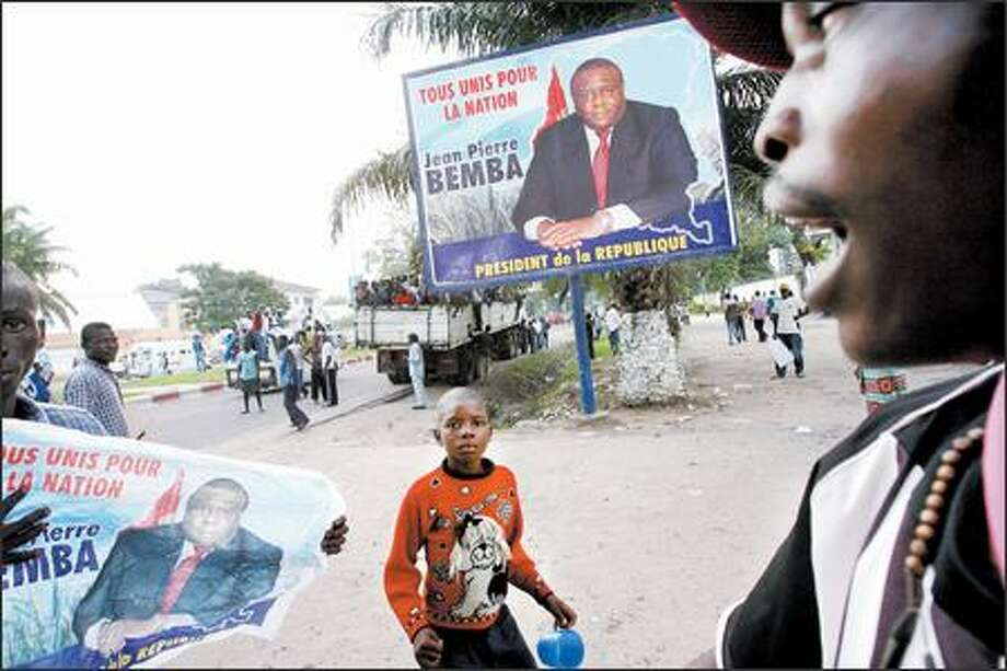 Supporters of presidential candidate Jean-Pierre Bemba show their support near his office in Kinshasa on Wednesday. Photo: / Associated Press