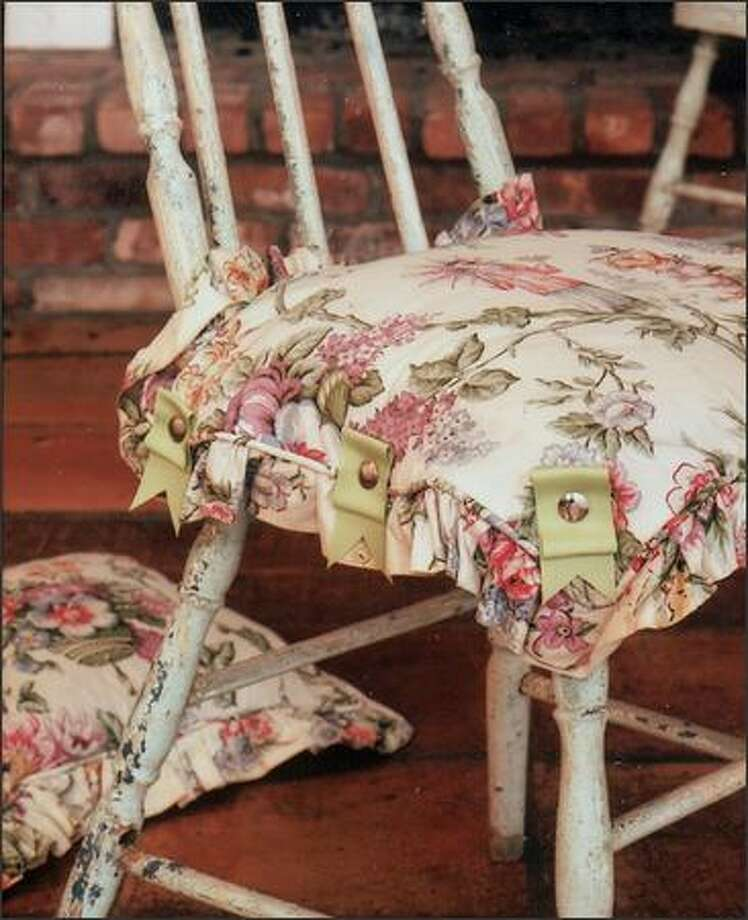 A premade pillow makes a lovely seat cover for a chair you might otherwise not want to sit on. Attach it with upholstery tacks. Photo: Paul Whicheloe For The Katie Brown Workshop