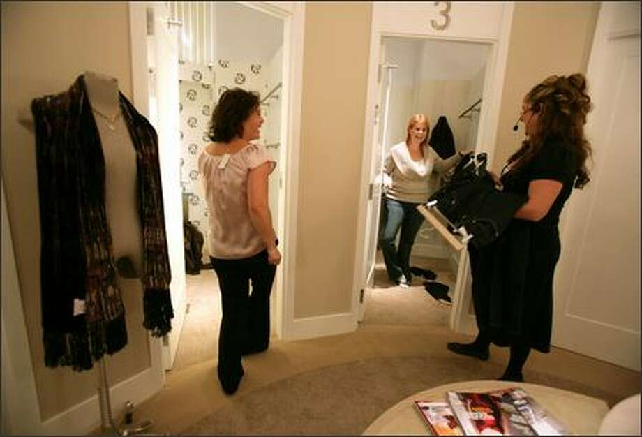 Shoppers Susan Koenigs, left, and Laura Mason, center, enjoy the dressing rooms at Forth & Towne and laugh with Gap style consultant Kelsey Lang, right. Photo: Meryl Schenker/Seattle Post-Intelligencer