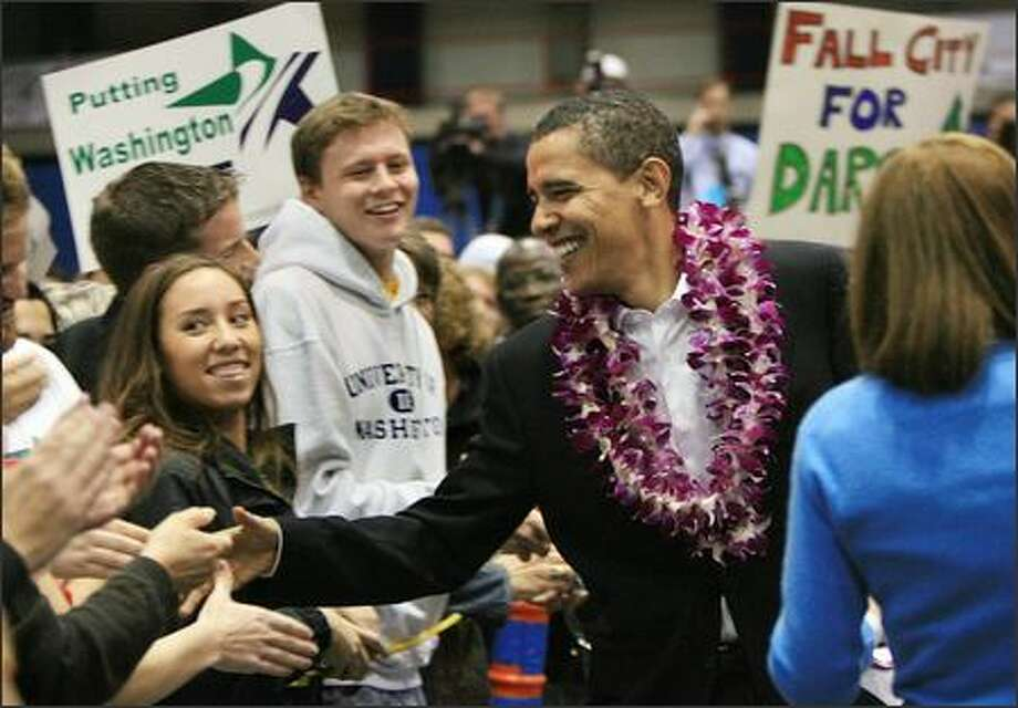 Illinois Sen. Barack Obama greets fans Thursday at Bellevue Community College, where he stumped for Sen. Maria Cantwell and House candidate Darcy Burner. View more photos from Obama's visit. Photo: DAN DELONG/P-I